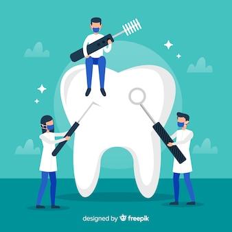 치과 의사가 큰 치아 배경 청소