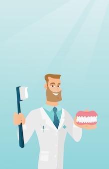 Dentist with a dental jaw model and a toothbrush.