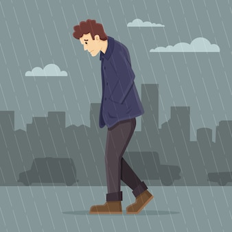 Depressed man walking in the rain
