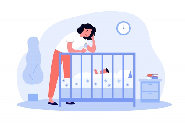 赤ちゃんにボトルを与えて落ち込んで疲れてママ