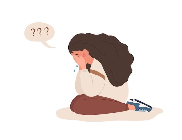우울한 여자입니다. 바닥에 앉아서 우는 슬픈 십 대.