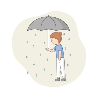 Depression concept. female character suffers from depression. sad woman standing with umbrella under the rain. overcast weather, emotions concealment.