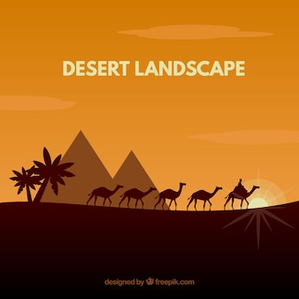 Desert landscape with pyramids and caravan