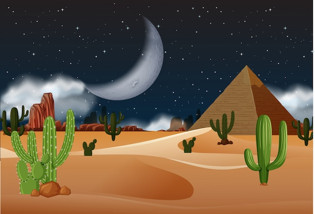 Desert with pyramids at night