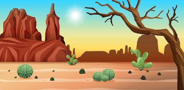 昼間のシーンで岩山とサボテンの風景と砂漠
