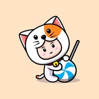 고양이 의상을 입은 귀여운 소년의 디자인은 큰 롤리팝 사탕 아이콘 그림을 안아줍니다.