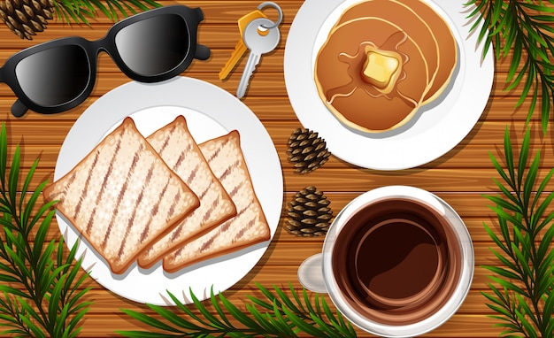 Desk close up with paper and coffee and pancake and glasses