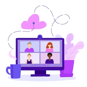 Desktop computer with group of colleagues taking part in video conference.