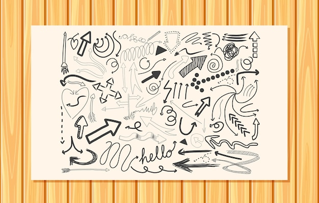 Different doodle strokes on a paper on wooden wall background