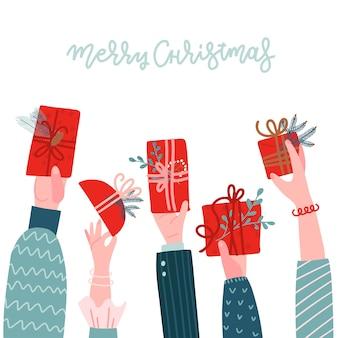 다른 인간의 손에 흰색 꽃 크리스마스 장식과 함께 선물 상자를 들고. 손으로 그린 플랫