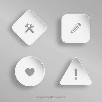 Different icons over white shapes