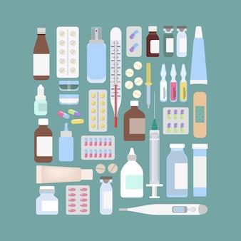 Набор разных лекарств. бутылки и таблетки, шприц и термометр.