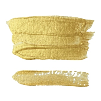 Different modern flickering brush strokes of gold paint on a white background. design element.