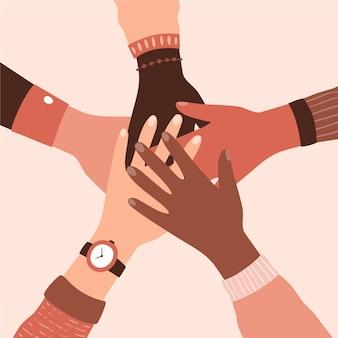 Разные люди держатся за руки в движении против расизма