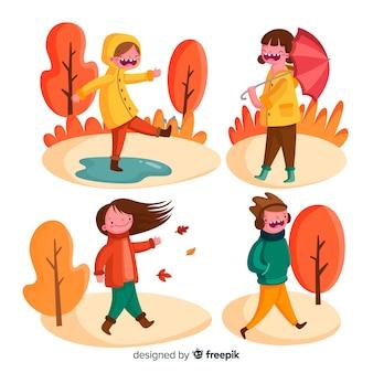 Diverse persone che camminano in autunno