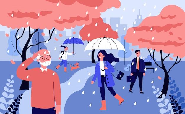 Разные люди гуляют под дождем