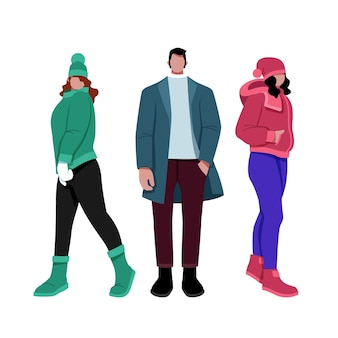 Different people wearing cozy winter clothes