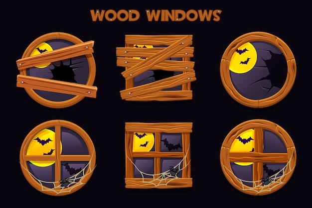 Различная форма и старые разрушенные деревянные окна, мультипликационные строительные объекты с паутиной и полная луна. элемент интерьера дома