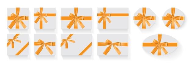 Коробки различной формы с оранжевым бантом вектор
