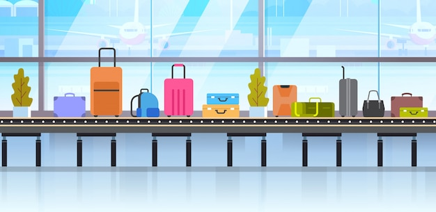 Different suitcases on baggage conveyor belt in airport