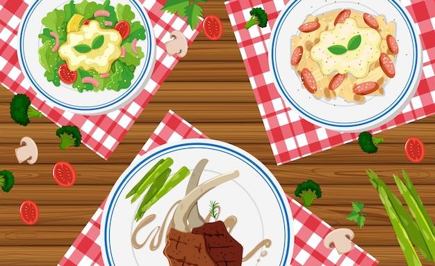 Различные виды продуктов питания на деревянном столе