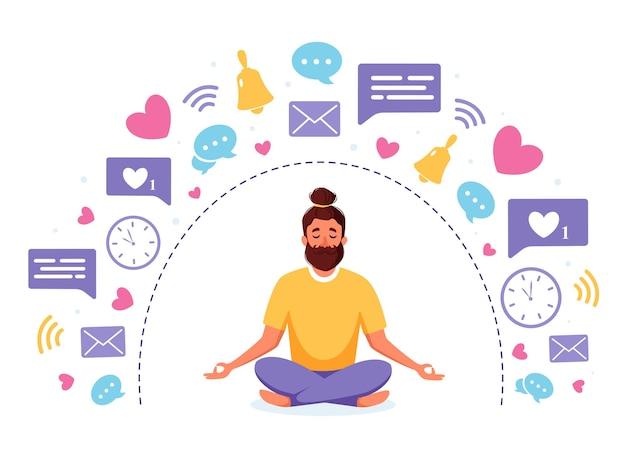 蓮華座で瞑想する男性とのデジタルデトックスと瞑想の概念