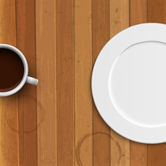 Dinner plate and coffee cup on wooden