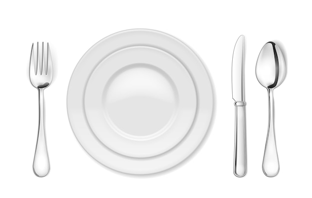 Обеденная тарелка, нож, вилка и ложка изолированные