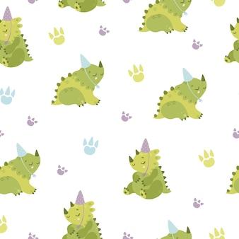 パーティーハットのシームレスなパターンを持つ恐竜