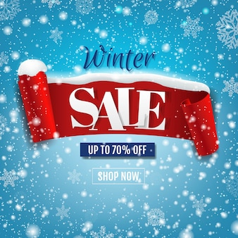 Discount winter banner with red ribbon with snow isolated on blue