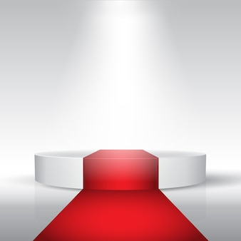 Display podium with red carpet under a spotlight