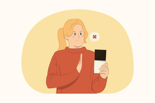 Displeased young woman showing stop gesture with palm to chocolate bar concept