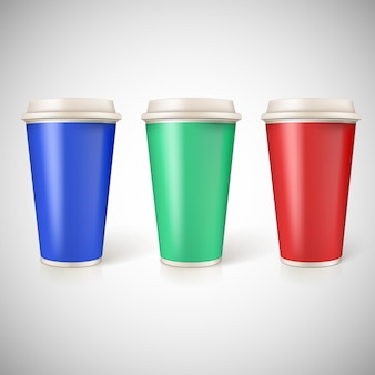 Disposable cups for coffee, closeup with multicolored labels.