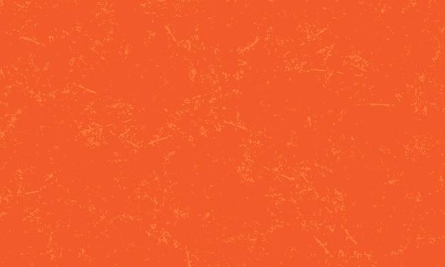 オレンジ色の背景の苦しめられたテクスチャ