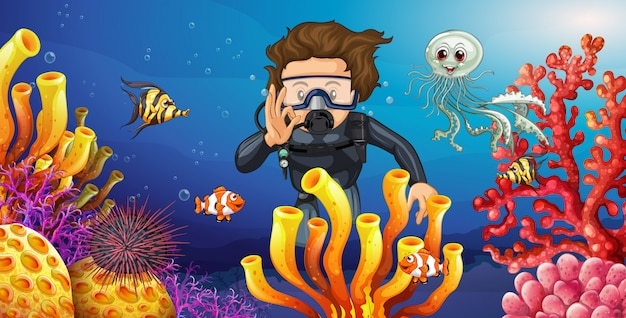Diver diving underwater with many sea animals