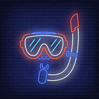 Diving mask neon sign. snorkel and glasses on brick wall