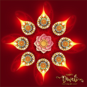Diwali, deepavali or dipavali the festival of lights india with gold diya patterned and crystals on paper