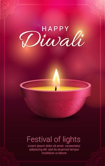 Diwali diya lamp with frame of rangoli decoration.