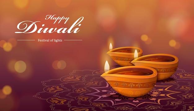 디야와 랑골리를 사용한 디왈리 축제 디자인은 보케 배경에 기름 램프와 바닥 장식을 의미합니다.