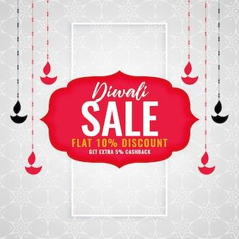 Fondo di vendita di stagione di diwali con diya d'attaccatura