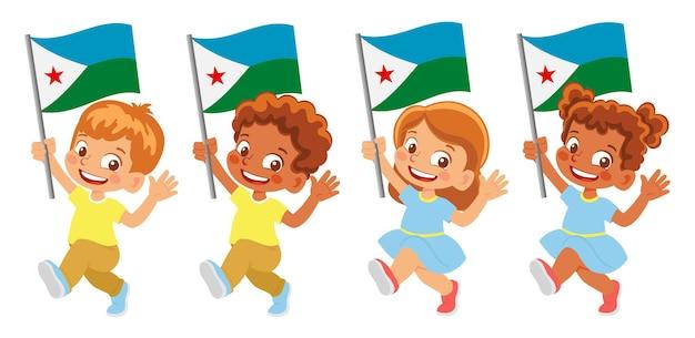 Флаг джибути в руке. дети держат флаг. государственный флаг джибути