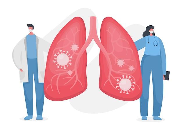 内部にコロナウイルスが感染したヒトの肺を示す医師と看護師