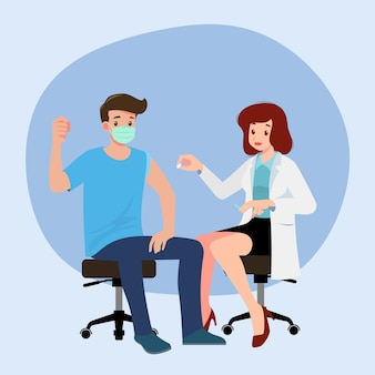 A doctor in a clinic giving a coronavirus vaccine to a man. vaccination concept for immunity health. virus prevention to medical treatment, process of immunization against covid-19 for people.