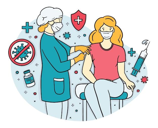 医者は女性患者にワクチンの注射をします