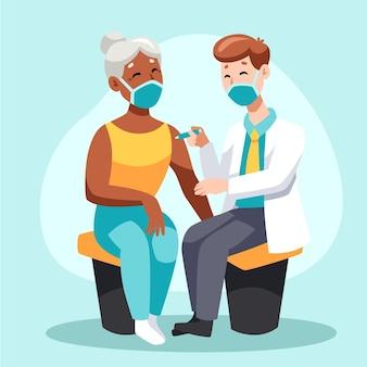 診療所の患者にワクチンを注射する医師