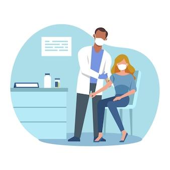 의사가 병원에서 환자에게 백신을 주입