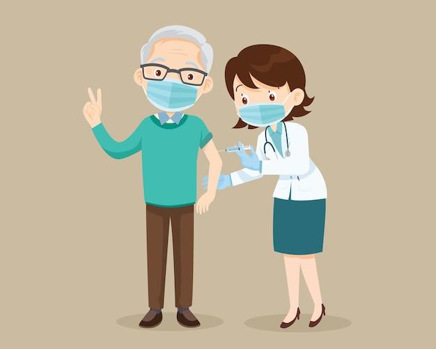 Doctor injection coronavirus vaccine to elderly man senior wearing face mask showing okay gesture