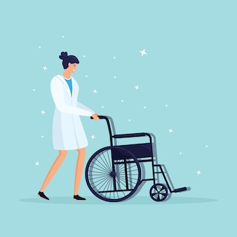 Doctor or nurse with wheelchair for senior patient