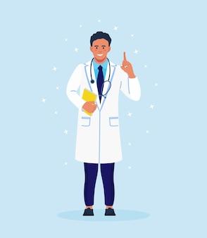 人差し指で上を向いて立っている医者。指を上に表示している医療用ガウンの幸せな笑顔の医師。フォネドスコープ、フォルダーを手に白衣を着た男性キャラクター
