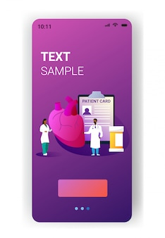 Doctors team examining human heart medical consultation internal organ inspection examination treatment cardiology concept mobile app vertical copy space full length